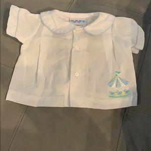 fa0512063 Alexis. White and blue Carousel Baby boy shirt